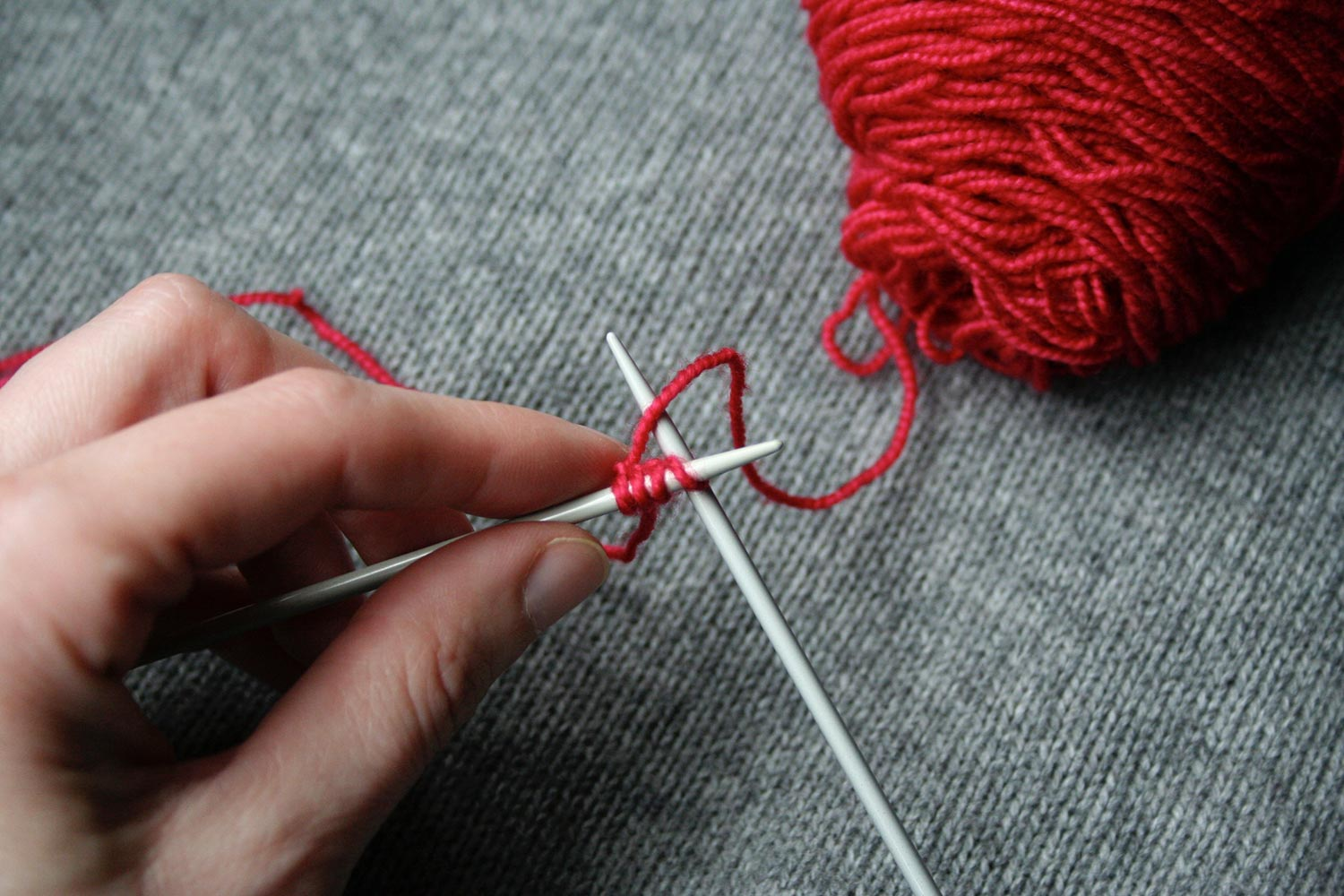 Right needle inserted knitwise into first stitch on left needle.