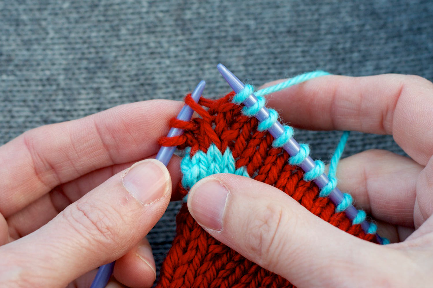 Left leg of stitch two rows below last stitch on right needle is raised onto left needle.