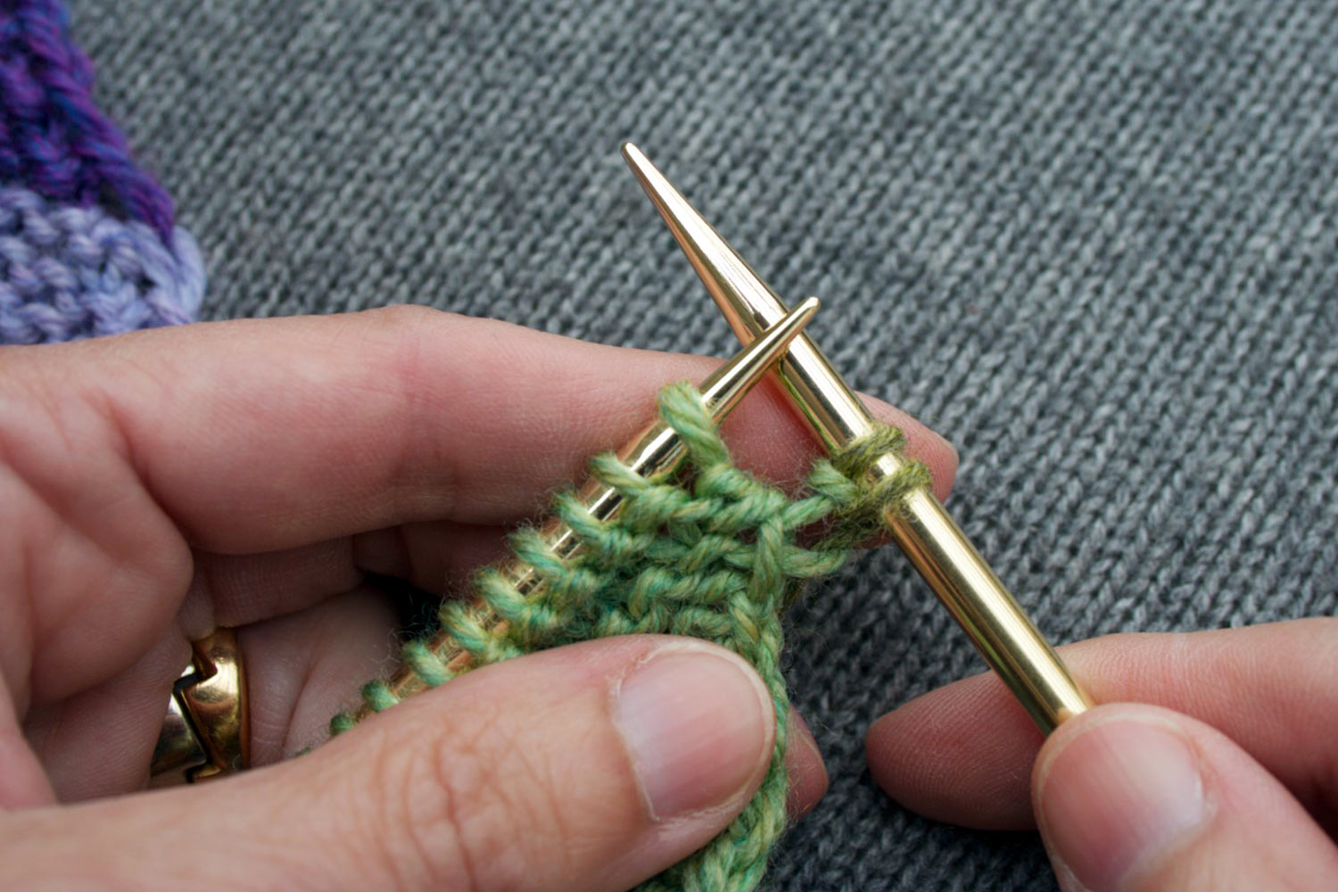 Two stitches on right needle showing the completed knit into the front and back (kfb) stitch.