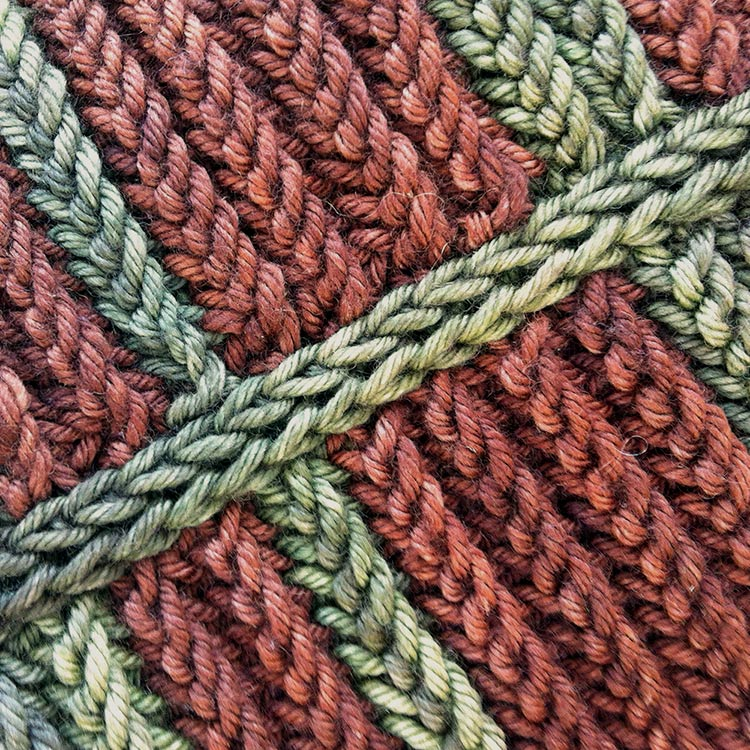 Double column of knit stitches joining two edges. Looks similar to a three needle bind off.