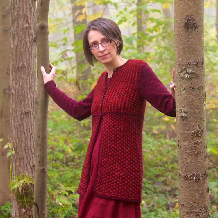 Tunic length fitted cardigan with mosaic stitch patterns.