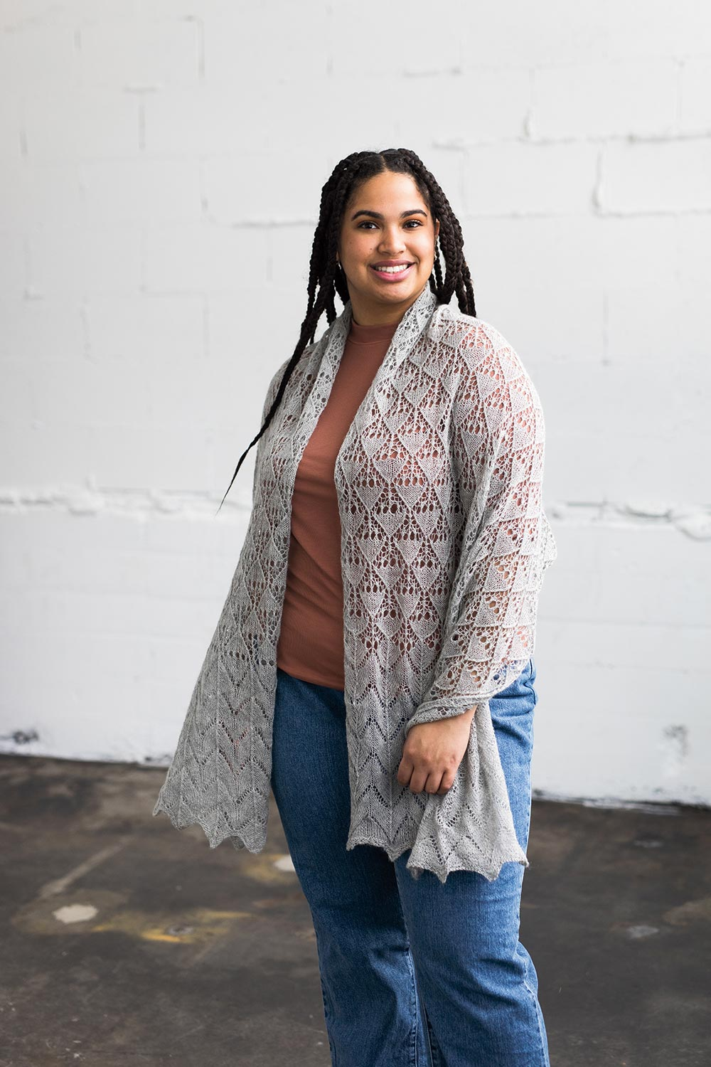 Rectangular lace shawl draped over shoulders.