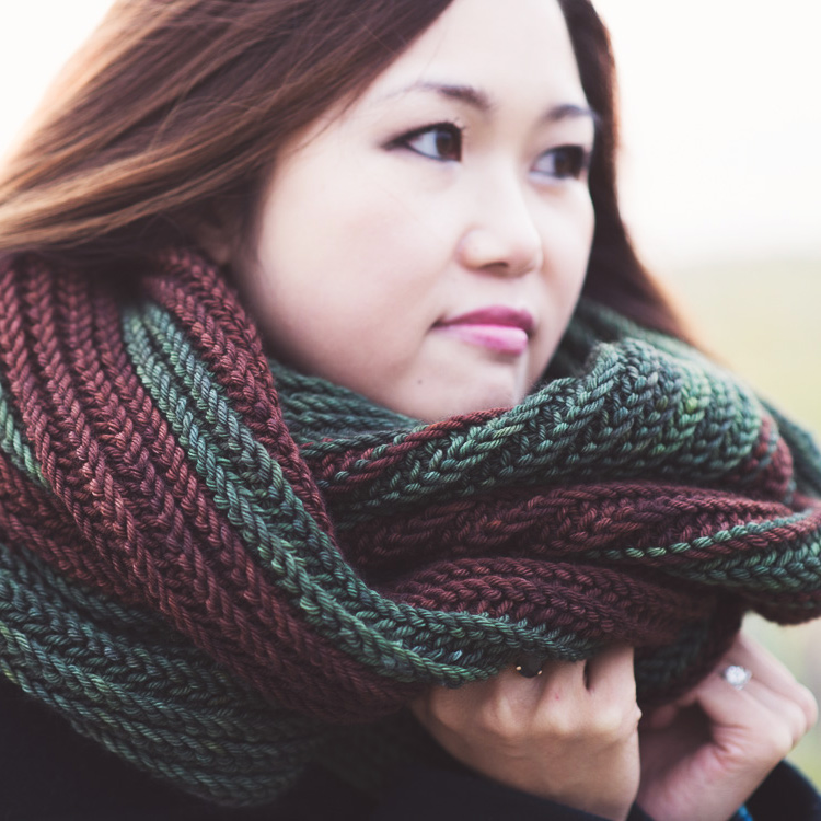 Deeply textured, oversized cowl with stripes.