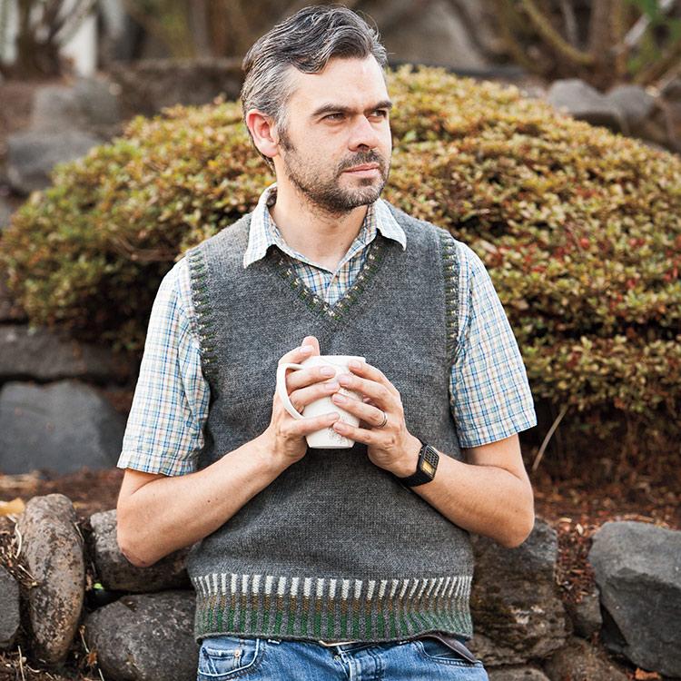 Classic v-neck vest with corrugated ribbing at hem, neckline and armholes.