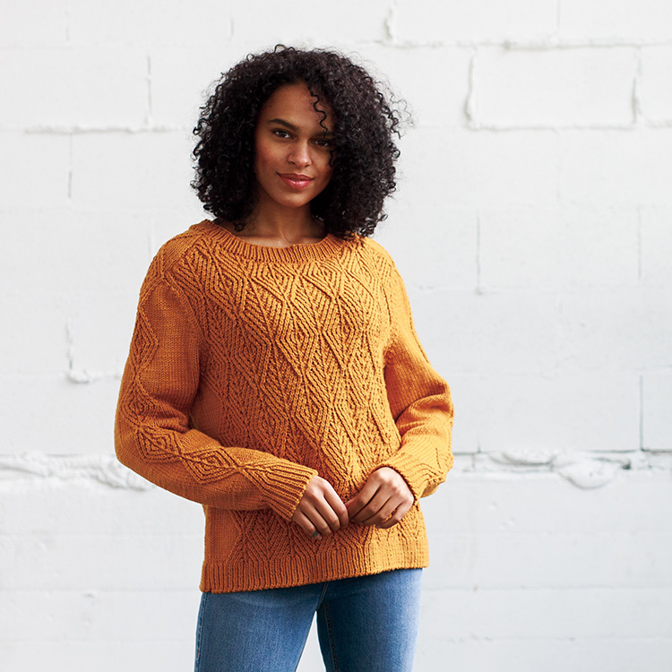 Loose-fitting, cabled pullover made of diamond motif twisted stitches.