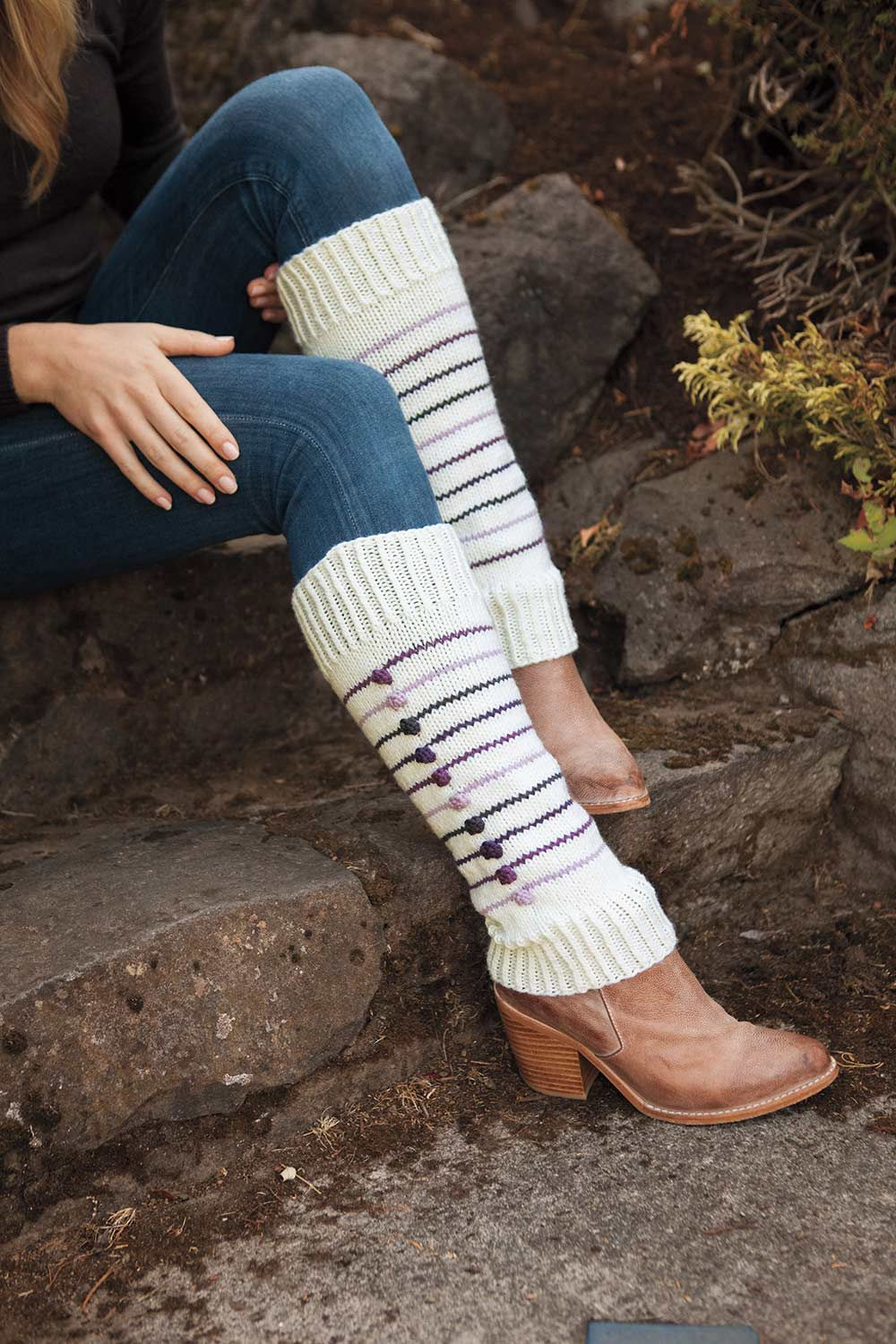 Leg warmers with colourful stripes and a single column of bobbles running down the leg.