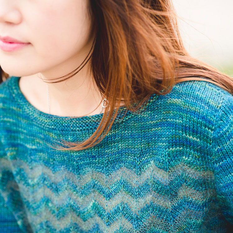 Pullover with striped chevron stitch pattern worked in different yarns.