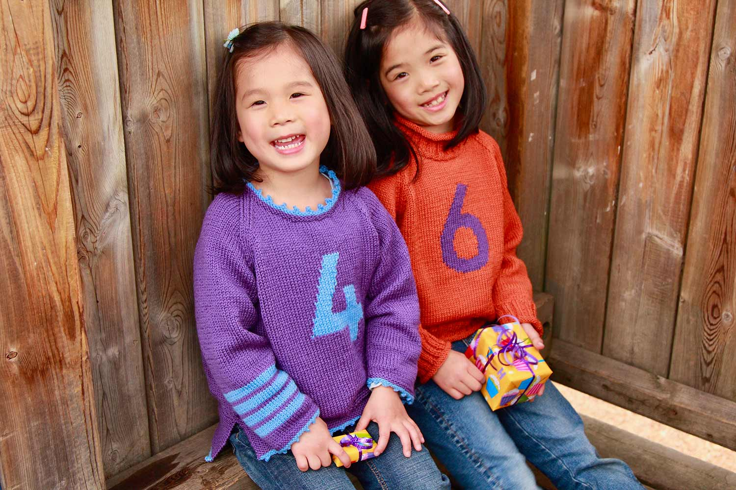 Child's raglan pullover with a large intarsia number on the chest and striped sleeve; customize with optional picot or ribbed edging.