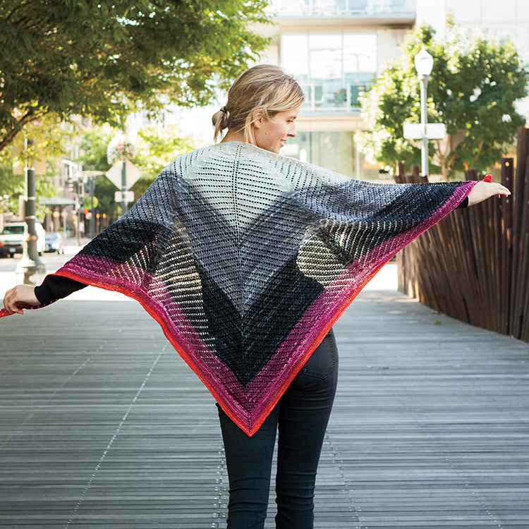 Top down triangular shawl with geometric eyelet lines worked in a gradient yarn.