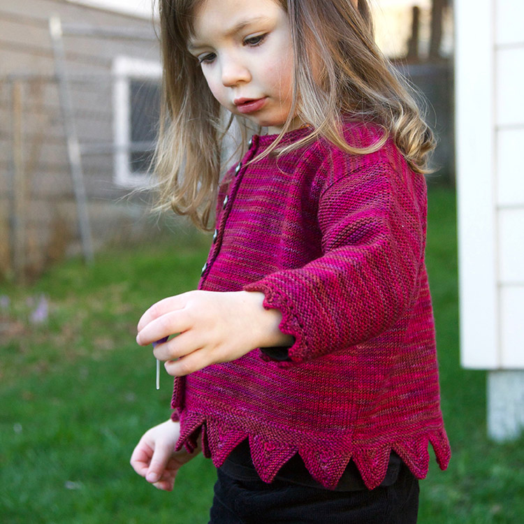 Boxy baby or child's cardigan with zigzag hem and cuffs.