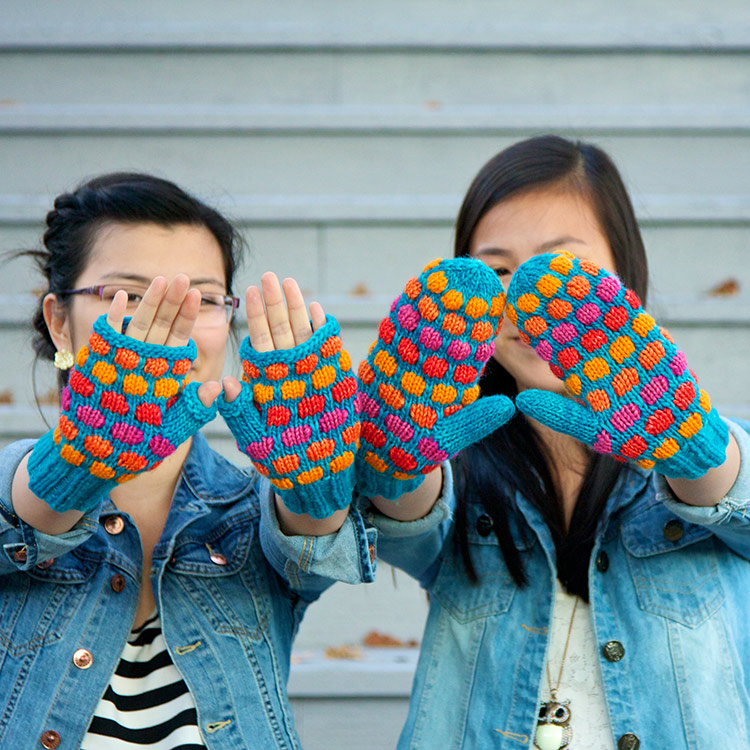 Colourful mittens with textured circle motif.