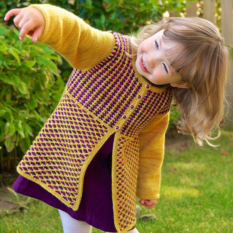 Child's tunic-length cardigan with easy slipped stitch colourwork.
