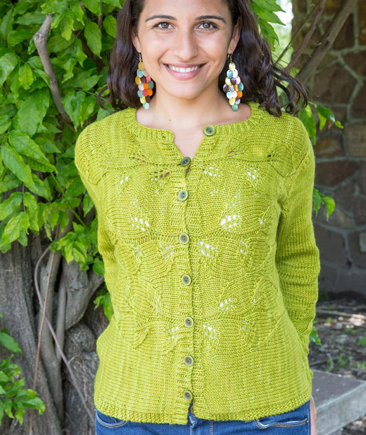 Buttoned cardigan worked from centre bands out on front with lace motif.