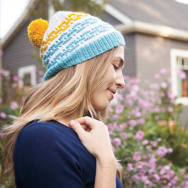 Multi-sized hat with mosaic stitch motifs worked in contrasting colours.