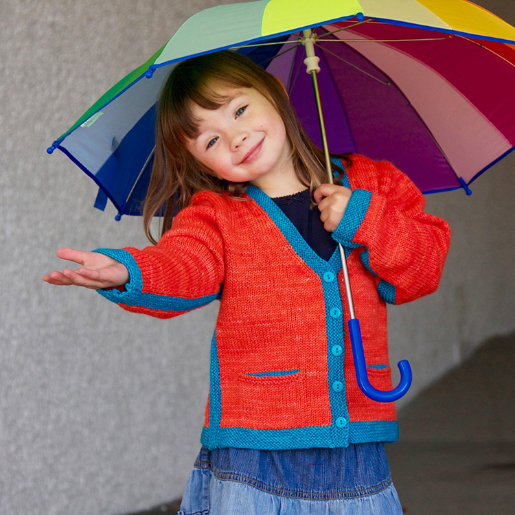 V-neck child's cardigan with pockets and colourful bands of garter stitch at seams and edging.