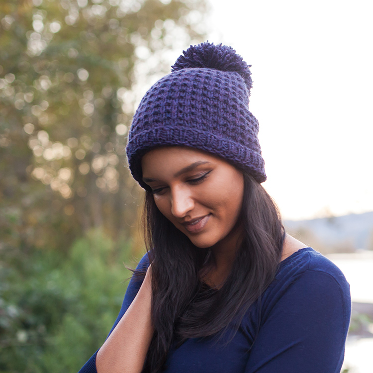 Textured hat in bulky weight yarn, worked from bottom up with huge, optional pompom.