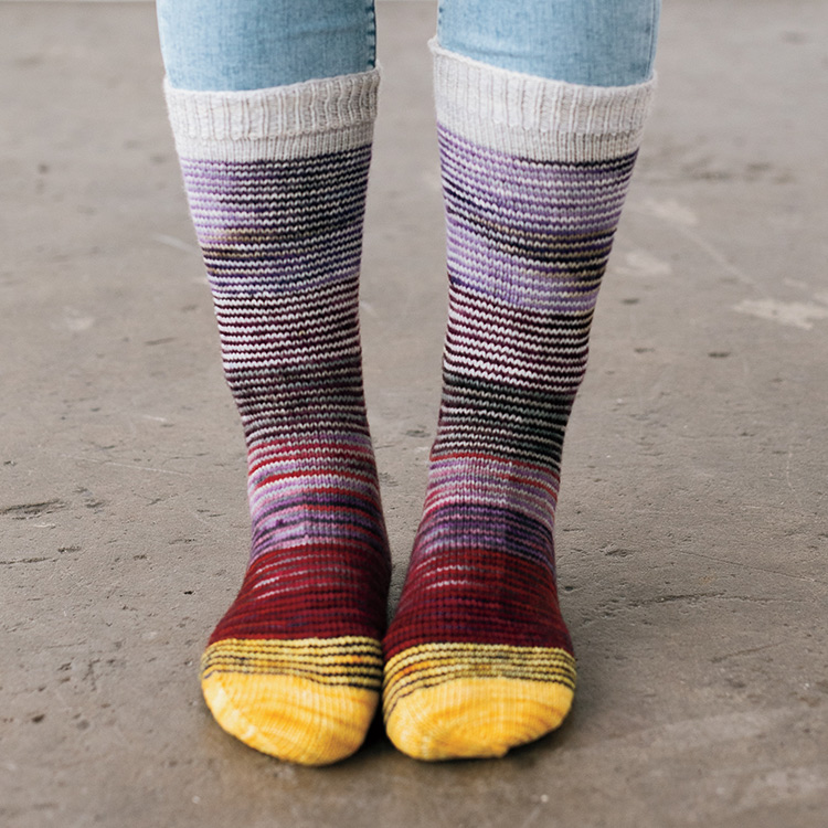 Striped socks with solid colour cuffs, heels, and toes.