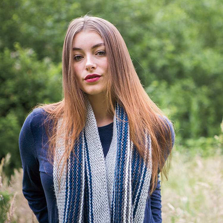 Long garter stitch cowl worked in multi-coloured stripes.