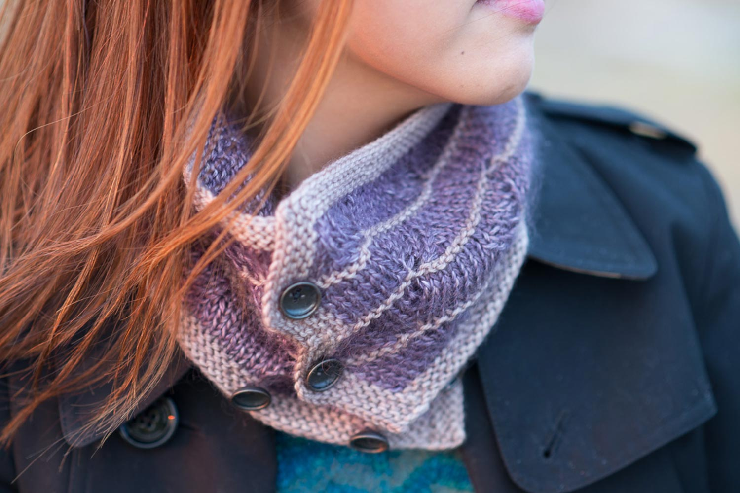 Buttoned neck warmer in luxury yarns featuring simple lace and garter stitch stripes.