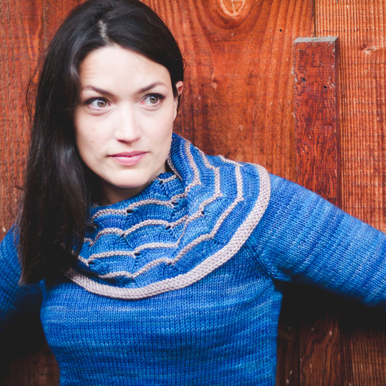 Tunic length pullover with raglan sleeves and large cowl neck.