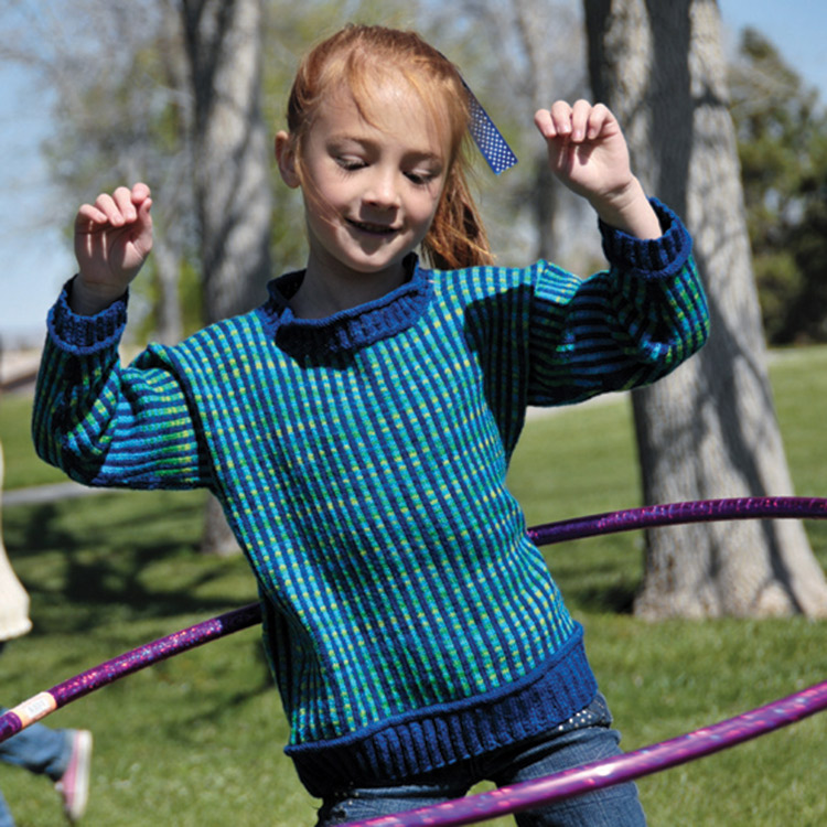 Child's pullover with vertical stripes in contrasting colours.