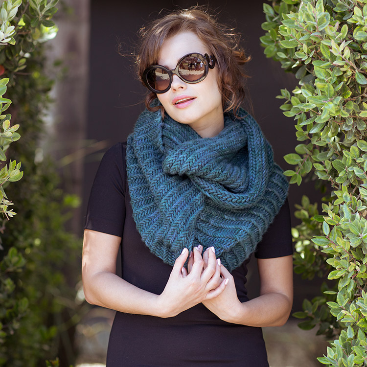 Huge bulky cowl with textured ridges wrapped twice around the neck.