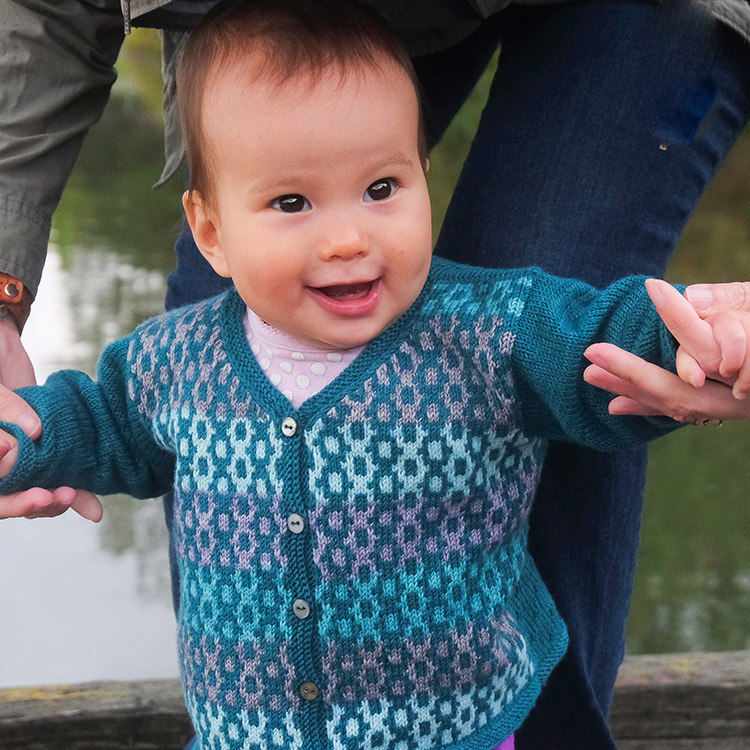 Baby and child's v-neck cardigan with mosaic stitch colourwork on fronts.