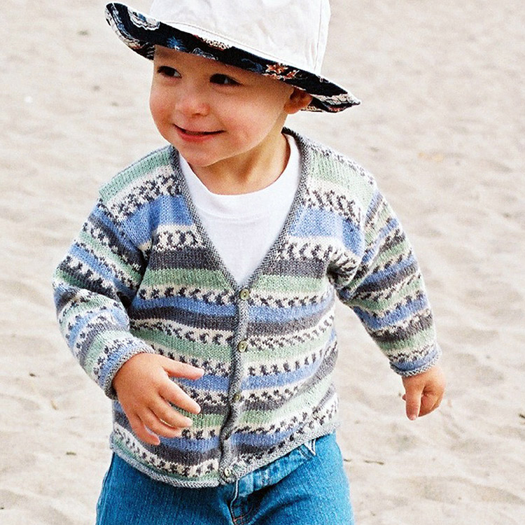 Toddler wearing a v-neck cardigan in a colourwork style that's made with just self-patterning sock yarn.