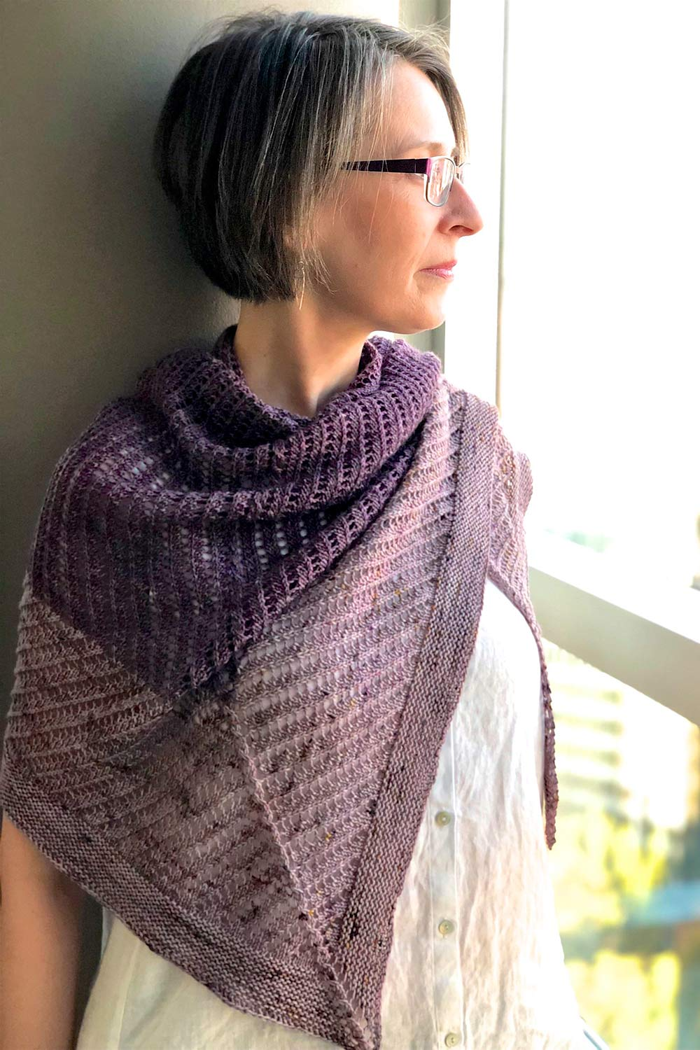 Holli wearing two-tone purple shawl wrapped around her neck.