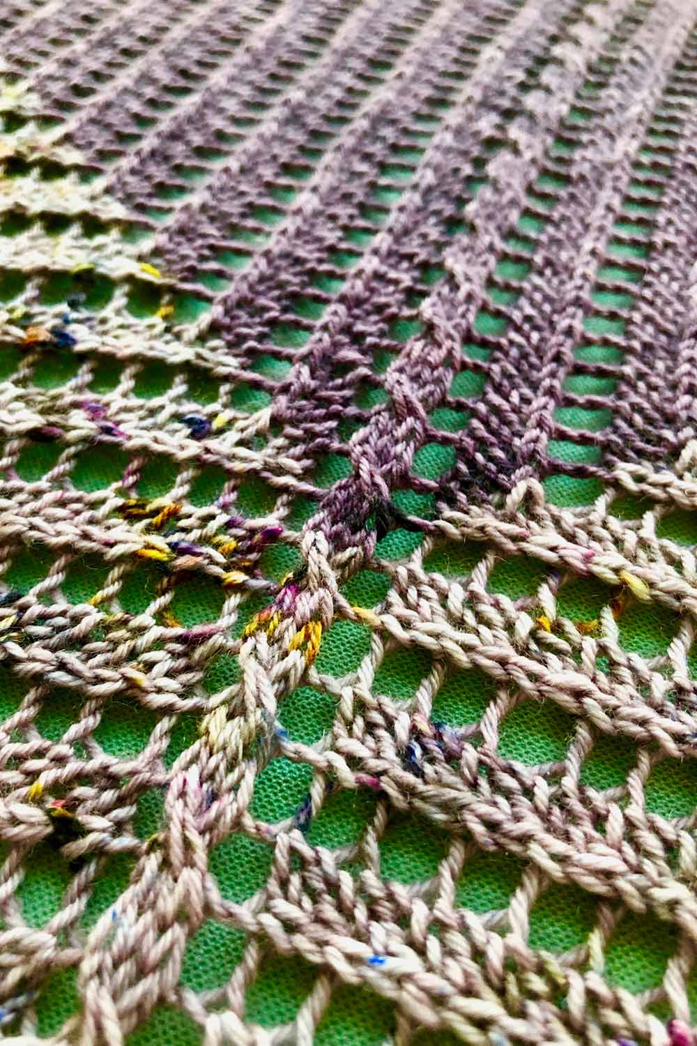 Detail shot of tiny cable pattern that runs along the spine of the triangular shawl.