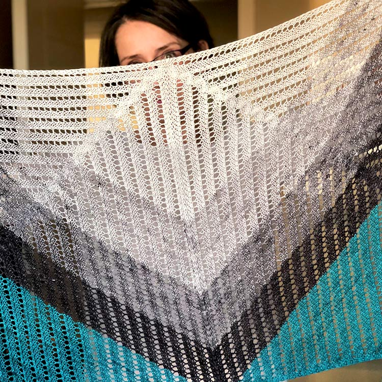 Rectangular shawl with a top down triangular shawl in the middle.
