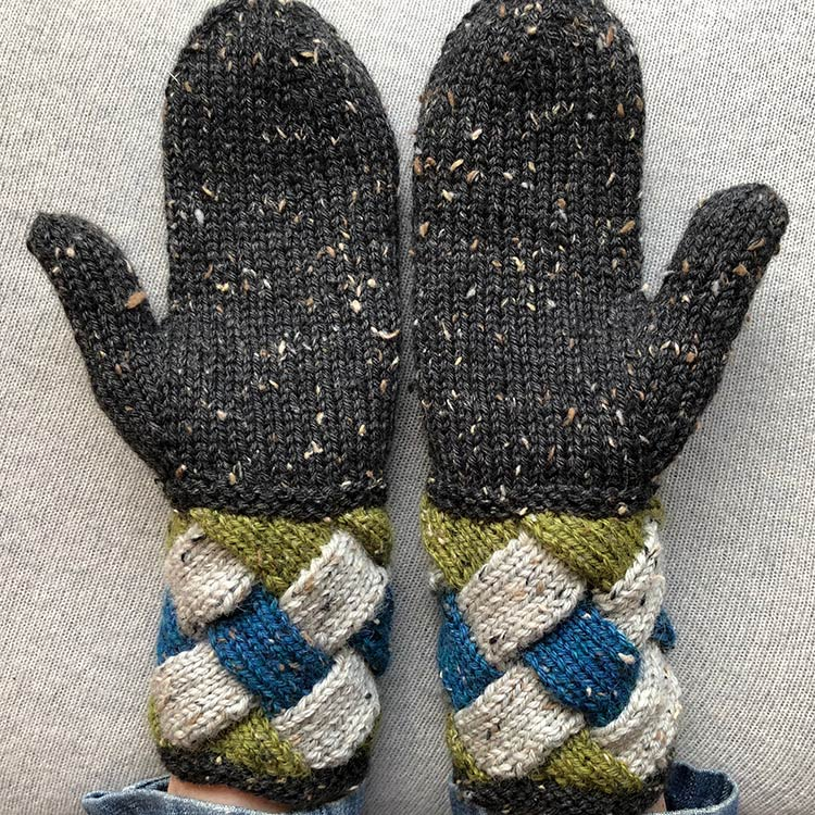 Mittens with a deep, multi-coloured entrelac cuff and solid-coloured stocking stitch hands.