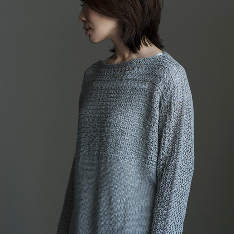 Tunic length linen pullover with decorative stitches across upper body and sleeves which are knit in one piece.