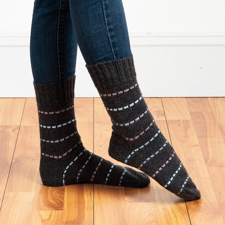 Socks with broken stripes in alternating contrasting colours worked in a slip stitch pattern.