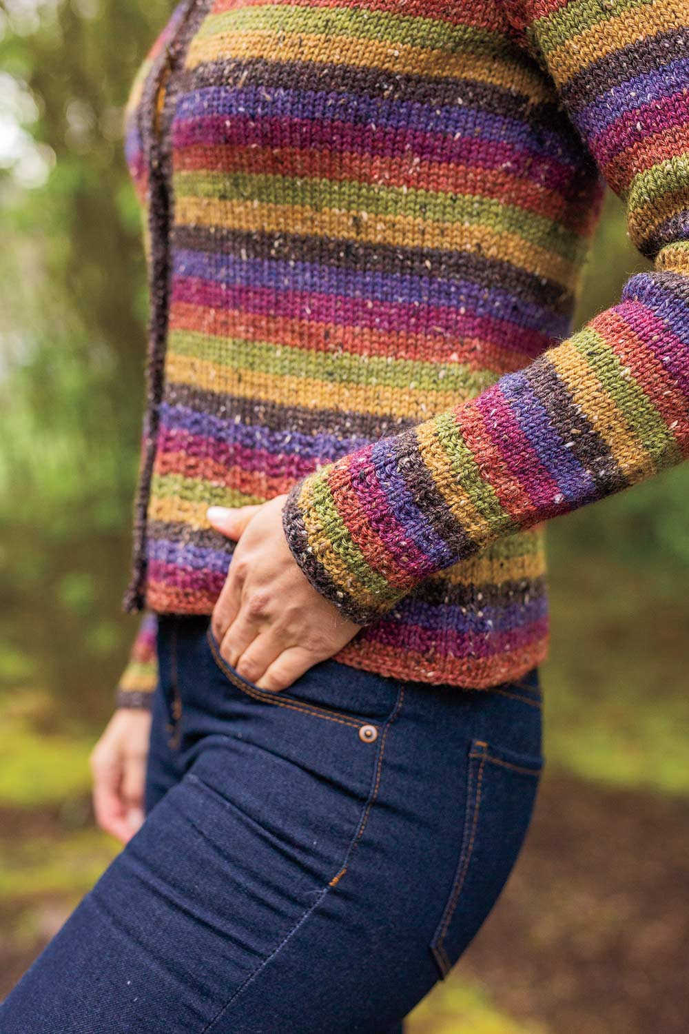 Detail shot of side of cardigan showing false seam. Sweater is worked top down in one piece.