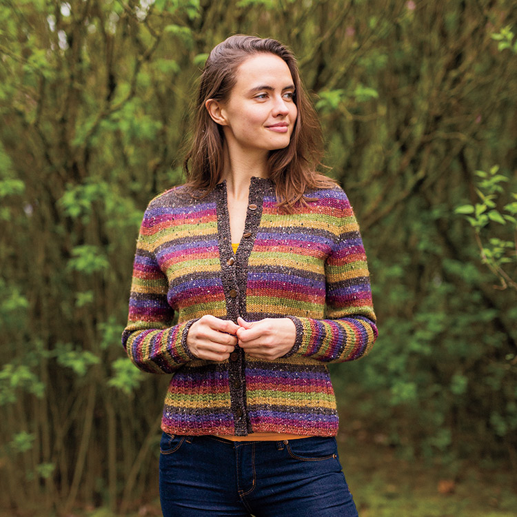 Striped cardigan with saddle shoulders and deep mock ribbed cuffs and hem.