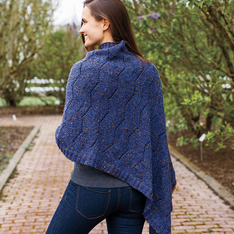 Poncho worked in an all over stitch pattern that ripples across the fabric in angles and eyelets.